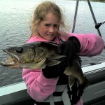 Girl holding fish caught signature fishing rods