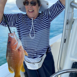 Joann is happy to catch Red Snappers
